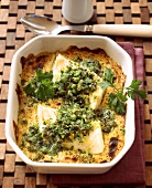 Oven-baked fish fillet with herb crust