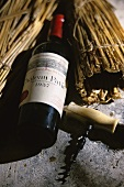 Chateau Pavie, 1937 vintage, corkscrew beside it, S. Emillon
