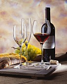 Red wine still life with Barolo, glasses, grapes & bread