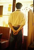 Sommelier (wine waiter) in restaurant, Bordeaux, France