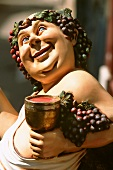 Bacchus, Roman god of wine, painted wooden figure