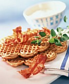 Buckwheat and bacon waffles and bowls of soft cheese dip