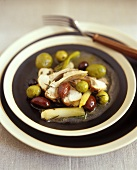 Braised rabbit with olives and spring onions