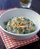 Glass noodle salad with turkey strips, mangetouts and chili