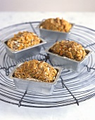 Four small vegetable and nut loaves in loaf tins