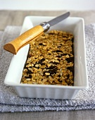 Flapjacks in baking tray; knife