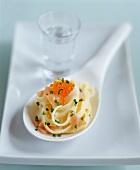 Noodles with smoked salmon & salmon caviare on china spoon