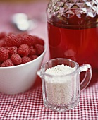 Ingredients for red berry compote (juice, barley, raspberries)