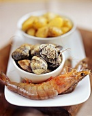 Still life with shrimps, mussels and potatoes
