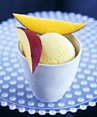 Mango & lemon ice cream in a tub