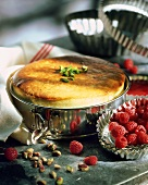 Quark souffle with raspberries and pistachios