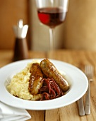 English sausages with mashed potato and red onions