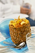 Tropical fruit salad, served in hollowed-out pineapple