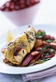 Chicken stuffed with cranberries on pepper and rhubarb salad