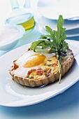 Cheese and salmon tartlet with fried egg (duck egg)