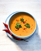 Pumpkin soup, garnished with coriander and chili