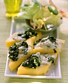 Polenta slices with spinach and gorgonzola
