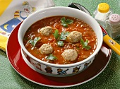Tomato soup with sausage dumplings, served in child's plate