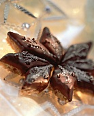 Oat and peanut diamonds with chocolate icing, forming a star