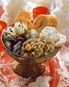 Various Christmas biscuits in decorative bowl