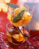 Bottled fruit: kumquats with herbs and figs in whisky
