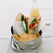Club sandwich and crisps in a lunch box