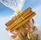 Cinnamon biscuits in cellophane bag with cinnamon sticks