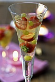 Champagne jelly with fruit, served in a champagne glass