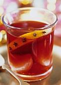 Mulled wine with mandarin oranges and orange slice