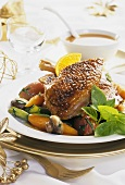 Roast goose with orange sauce and vegetables