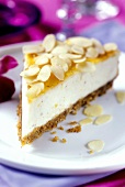 A piece of ricotta cheesecake with flaked almonds