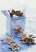 Gingerbread stars in front of and in a metal box