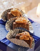 Three walnut chocolates on a gift box
