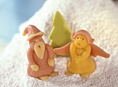 Christmassy marzipan figures on artificial snow