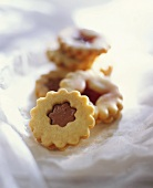Sweet pastry biscuits with nougat and jam filling