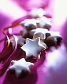 Cinnamon stars on purple background