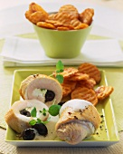 Turkey rolls with sheep cheese & olive filling & potato crisps