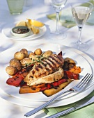 Grilled chicken steaks with marinated pepper & potatoes