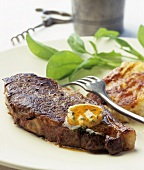 Beef steak with herb and mustard butter