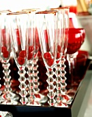 Tray of champagne flutes (with raspberries in) and glasses