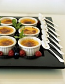 Crème brulee in moulds on party tray