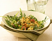 Mussel salad with rocket, bacon and garlic dressing