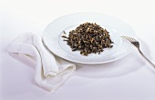 Boiled wild rice on white plate