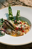 Seafood soup with spring vegetables and flowers