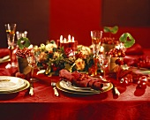 Table laid in shades of red for Christmas