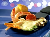 Raclette pan with vegetables, shrimps, cheese