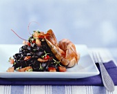 Shrimps with tomatoes and garlic and black noodles