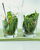 Mangetout salad and green bean salad in two glasses