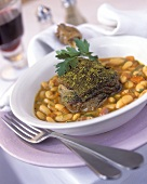 Duck leg with herb crust on bean cassoulet