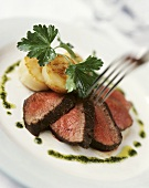 Venison fillet with fried scallops